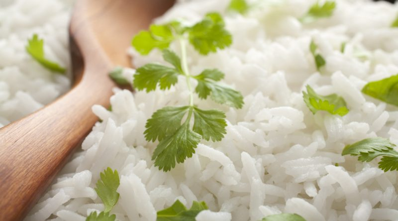 Close-up of basmati rice with coriander, with a spoon. Traditional accompaniment to Indian curry. More curry [url=http://www.istockphoto.com/file_search.php?action=file&lightboxID=3096983]here[/url].